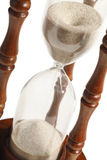 Hourglass macro. A close-up of hourglass with sand sifting through Stock Photo