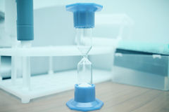 Hourglass macro on the desktop in a laboratory. Of hospital Royalty Free Stock Photos