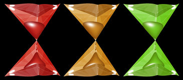 Hourglass made of faceted triangles. This is the hourglass. They are red, gold and green. They are made of faceted triangles Stock Image