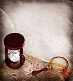 Hourglass with a magnifying glass. Royalty Free Stock Photos
