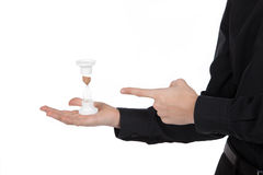 Hourglass in male hand on a white background Stock Photos