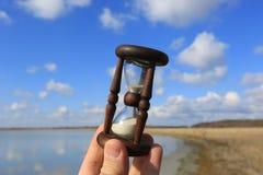 Hourglass in man hand Stock Photo