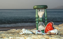 Hourglass on marine beach , Eilat, Israel Royalty Free Stock Image