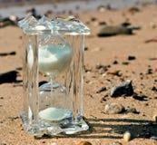 Hourglass on marine beach Stock Image