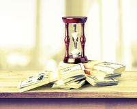 Hourglass on Money Royalty Free Stock Image