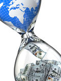 Hourglass, money and earth. Consumption of natural resources. Stock Image