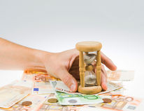 Hourglass and money Royalty Free Stock Image