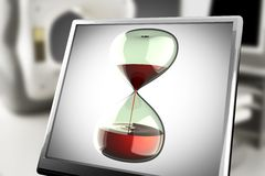 Hourglass on monitor in laboratory Stock Photo