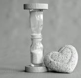 Hourglass mono with heart Stock Photos