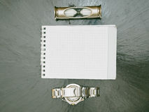 Hourglass notepad and watch lying on the table retro style Stock Photography