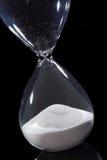 Hourglass odizolowywający na czerni Zdjęcia Stock
