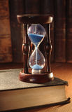 Hourglass And Old Books Stock Images