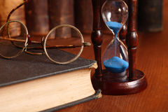 Hourglass And Old Books Stock Image
