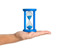 Hourglass on palm isolated. Royalty Free Stock Images