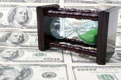 hourglass pieniądze Obrazy Royalty Free