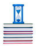Hourglass on pile of books isolated. Royalty Free Stock Photos