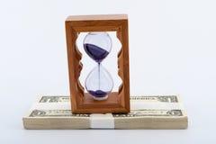 Hourglass on money royalty free stock photos
