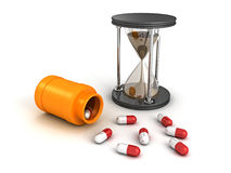 Hourglass and prescription bottle with medical pills Royalty Free Stock Image