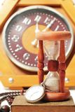 Hourglass and retro vintage clock Royalty Free Stock Photography