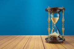 Hourglass retro on wooden table Royalty Free Stock Images