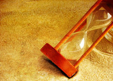 Hourglass in the sand Royalty Free Stock Photography