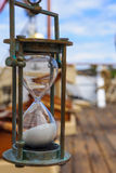 Hourglass (Sand Clock) on an old Ship Royalty Free Stock Images