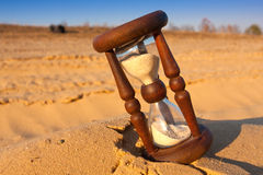 Hourglass on sand Royalty Free Stock Image