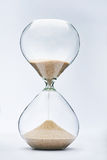 Hourglass. With sand falling on white background Royalty Free Stock Photography