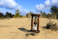 Hourglass on sand Royalty Free Stock Photo