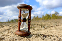 Hourglass on sand Stock Photo