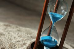 Hourglass on sand. Time management concept royalty free stock images