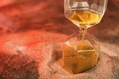 Hourglass on sand. Time management concept stock photography