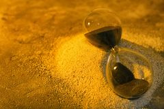 Hourglass on sand. Time management concept stock photos