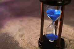 Hourglass on sand. Time management concept stock images