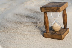 Hourglass in Sand Stock Images