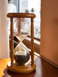 Hourglass, sandglass. Sandglass, hourglass on table near window Stock Photography