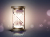 Hourglass with shining light Royalty Free Stock Image
