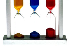 Hourglass viewing,hourglass picture,hourglass image,speed,slow,concept. Metaphorical representation of speed . Three hourglasses are emptied at different speeds Royalty Free Stock Images