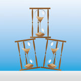 Hourglass. Stack hourglass in the table Royalty Free Stock Images