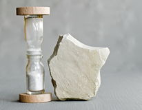 Hourglass and stone Royalty Free Stock Photography