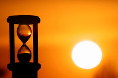 Hourglass in sunset. Hourglass in sky sunset showing the finish time royalty free stock photo