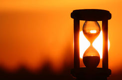 Hourglass in sunset. Hourglass in sky sunset showing the finish time stock photography