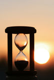 Hourglass in sunset. Hourglass in sky sunset showing the finish time royalty free stock photos