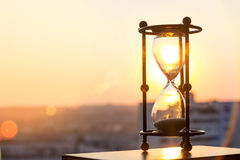 Hourglass at sunset. In the evening Royalty Free Stock Image