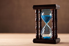 Hourglass on table Royalty Free Stock Images