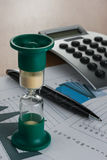 Hourglass on the table businessman Stock Images