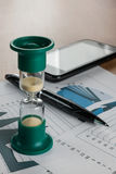 Hourglass on the table businessman Royalty Free Stock Photos