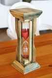 Hourglass on the table Royalty Free Stock Photography