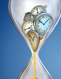 Hourglass time clock. With sand flow Stock Photo