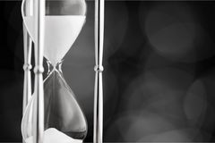 Hourglass. Time glass sand falling shape macro Royalty Free Stock Image
